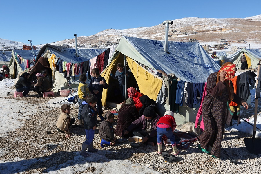 Syrian refugees on the Syrian border with Lebanon